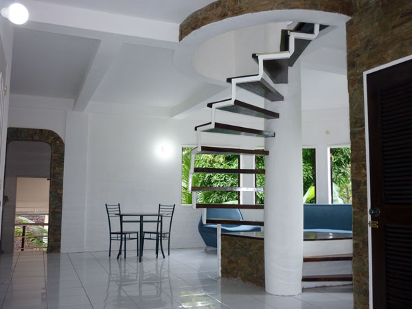 view from foyer to spiral staircase leading to private master area